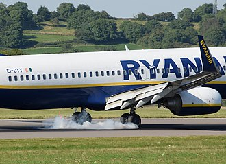 Landing - Boeing 737-800 of Ryanair makes a smoky landing at Bristol Airport (2016)