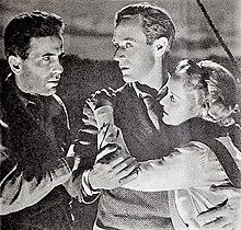 Bogart and Leslie Howard looking at each other, with Davis clinging to Howard