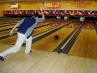 A ten-pin bowler releases the ball