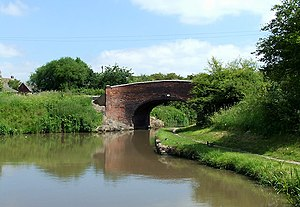 Bedworth - Bridge No 13, Coventry Canal, Bedworth Hill Bridge. The Act of Parliament for construction of the Coventry Canal under James Brindley was passed in 1768, and runs via Nuneaton and Atherstone to Fradley Junction near Lichfield. Completed in 1789.