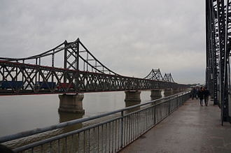Dandong - Bridge from Sinuiju, North Korea across the Yalu River to Dandong with North Korean trucks coming into China.