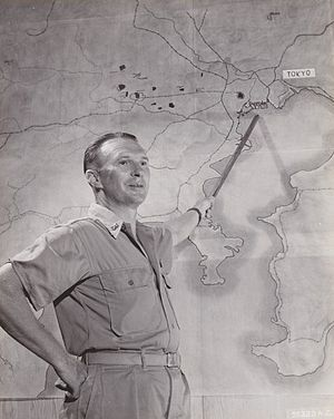 Haywood S. Hansell - Brigadier General Hansell posing with a map of the Tokyo region during November 1944