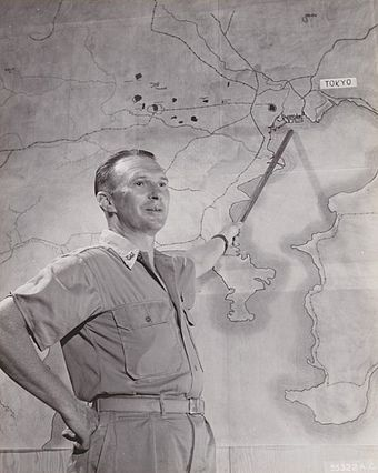 Brigadier General Haywood S. Hansell posing with a map of the Tokyo region in November 1944 Briefing for attack on Tokyo November 1944.jpg
