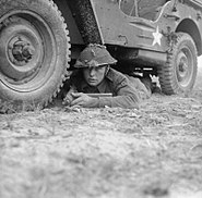 British soldier beneath a jeep.jpg
