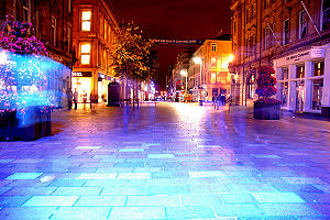 Image of Buchanan Street (Glasgow) at night.