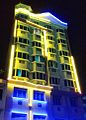 Building at Lorong 15 Geylang, Singapore, illuminated with fluorescent tubes.jpg