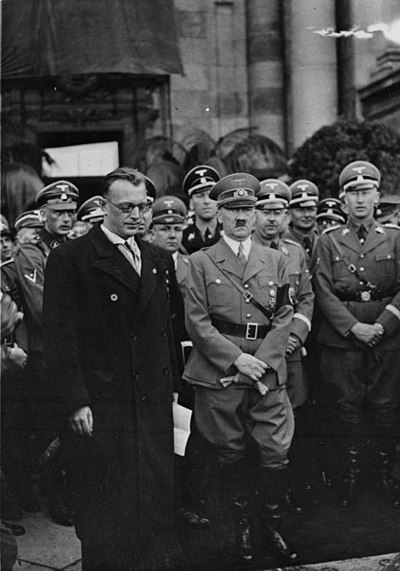 Seyss-Inquart and Hitler with Himmler and Heydrich to the right in Vienna, March 1938 Bundesarchiv Bild 119-5243, Wien, Arthur Seyss-Inquart, Adolf Hitler.jpg