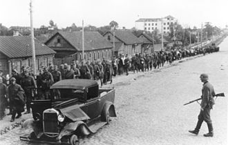 Battle of Białystok–Minsk - Soviet soldiers march into captivity in Minsk on 2 July 1941.