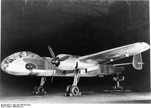Junkers Ju 288 - Ju 288 V1 prototype with twin BMW 801 engines. Is it being held in flying attitude by a support under the tail. The actuator rods for the landing gear are visible behind the main struts.