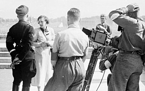 Leni Riefenstahl - Riefenstahl stands near Heinrich Himmler while instructing her camera crew at Nuremberg, 1934