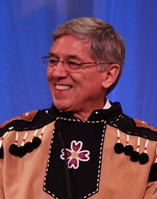 Mallott smiling, wearing native Tlingit dress