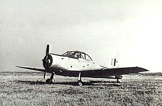 Single-engined military monoplane parked on airfield