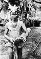 COLLECTIE TROPENMUSEUM Een man van de Mentawai-eilanden met een trom TMnr 10005504.jpg