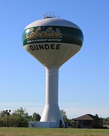 Photograph of the water tower in Dundee emblazoned with the Cabela's logo.