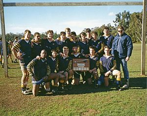 California Golden Bears rugby - The 1989 Cal Rugby team in possession of the scrum axe.