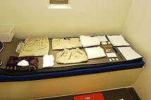 Camp 5 cell, and a captive's issued items.JPG