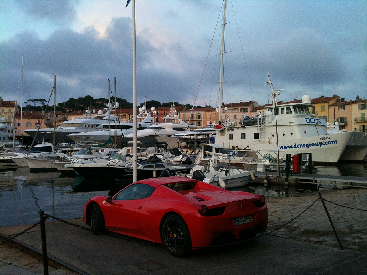 Cars, yachts and a small village - panoramio.jpg