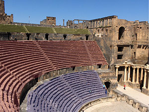 Cavea - The different levels of the cavea in the Roman Theatre at Bosra. Ima cavea in blue, media cavea in red and summa cavea in yellow.