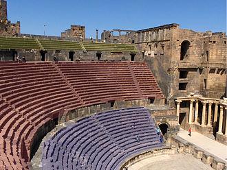 Cavea - The different levels of the cavea in the Roman Theatre at Bosra. Ima cavea in blue, media cavea in red and summa cavea in yellow.