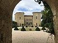Château de Sérillac through entrance arch.jpg