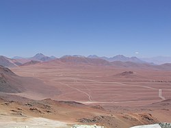 Llano de Chajnantor from Cerro Toco. APEX (left) and CBI (far center) can be seen