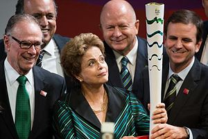 2016 Summer Olympics torch relay - President Dilma Rousseff holding the Olympic torch, accompanied by the president of BOC Carlos Arthur Nuzman (left), and the Mayor of Rio de Janeiro, Eduardo Paes (right).