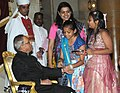 Children tying 'Rakhi' to the President, Shri Pranab Mukherjee, on the occasion of 'Raksha Bandhan', in New Delhi on August 10, 2014 (4).jpg