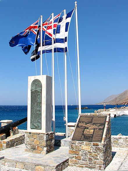 Monument to the Battle of Crete in Sfakia with the flags of Greece, the United Kingdom, Australia, and New Zealand Chora Sfakion 1941 evacuation monument.jpg