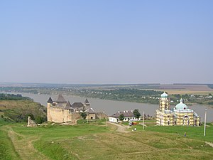 Dniester - The Dniester in Khotyn (western Ukraine). Another Moldavian fortress and an Orthodox church seen on foreground.