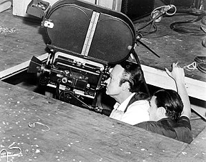 Low-angle shot - Low-angle shot being filmed for Citizen Kane, in which a hole was cut in floor of the studio to achieve the perspective desired for the scene.