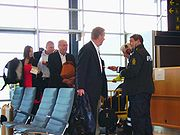 Danish civil servants queuing after their foreign minister for an airport passport check