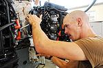 Coast Guardsman Tunes Boat Motor DVIDS178922.jpg