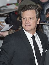 A close up portrait of a middle aged man in a dinner jacket entering a film event