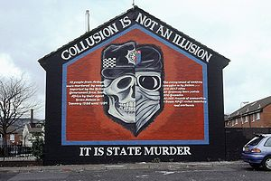 "A mural in Belfast graphically depicting the collusion between British security forces and Ulster loyalist groups; Image reads: ""Collusion is not an illusion, it is state murder"""