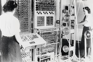 A Colossus Mark II computer. The slanted control panel on the left was used to set the pin patterns on the Lorenz; the paper tape transport is on the right.