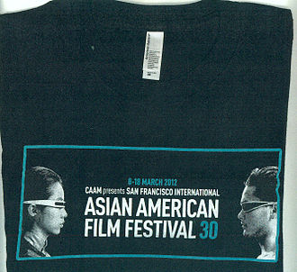 Center for Asian American Media - Commemorative T-shirt made for the 30th anniversary of the San Francisco International Asian American Film Festival in 2012. The image shows actors Tiana Alexandra and Mark Dacascos