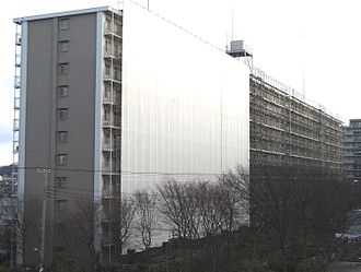 Scaffolding - A condominium in periodical (every 10-15 years) large scale repairing/maintenance in Japan under regulation. In most cases the entire building is covered by steel scaffolding and mesh for easy work and safety. Typically it continues 3-5 weeks per planned schedule.