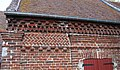 Courbes Agencement de briques sur le mur de la mairie.jpg