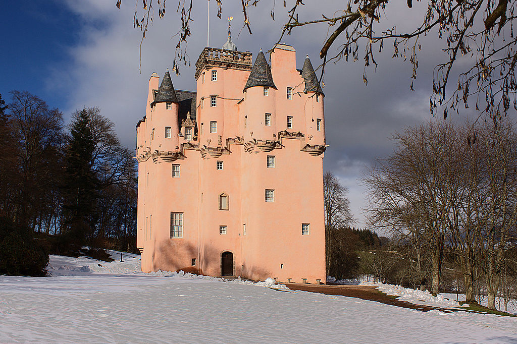 the pink Craigievar Castle during the winter