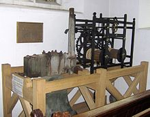 Wooden framework containing metal mechanical mechanism.