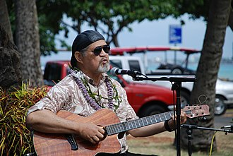 Tacoma Guitars - Hawaiian slack key guitarist playing a Tacoma EKK19c guitar made out of Koa wood.
