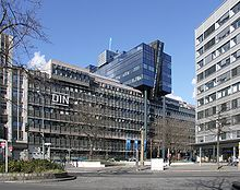 DIN headquarters is a modern 7-story office building with their logo on the front