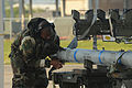 Defense.gov News Photo 100412-F-3197B-115 - U.S. Air Force Senior Airman Hanson Blaylock with the Aircraft Maintenance Squadron 159th Fighter Wing installs a tail fin on an AIM-120 AMRAAM.jpg