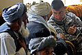 Defense.gov News Photo 110126-F-2185F-072 - U.S. Army 2nd Lt. Paul Knudtson speaks to a Shah Joy village elder during a shura at the Shah Joy District Center in Afghanistan s Zabul province.jpg