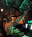 Defense.gov News Photo 110324-F-LR266-539 - Staff Sgt. Troy Miller checks fuel tank levels from the flight deck of a C-130 Hercules aircraft at Little Rock Air Force Base Ark. on March 24.jpg