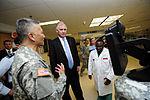 Defense.gov News Photo 110928-F-RG147-298 - Army Maj. Gen. M. Ted Wong tells Deputy Secretary of Defense William J. Lynn III about an advanced medical monitor that utilizes videoconferencing.jpg