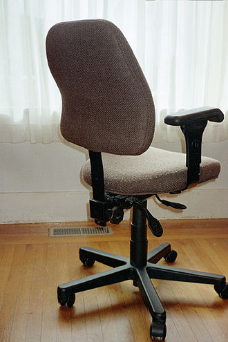 Office chair - An office chair that can swivel and be adjusted to various heights and angles
