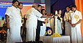 Dharmendra Pradhan and the Minister of State for Road Transport & Highways and Shipping, Shri P. Radhakrishnan lighting the lamp on the occasion of the Golden Jubilee Celebrations of Chennai Petroleum Corporation Limited.jpg
