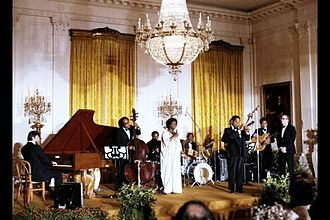 Sarah Vaughan - Dizzy Gillespie and Sarah Vaughan perform at the White House for a State Dinner in honor of the Shah of Iran on November 15, 1977.