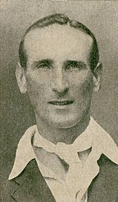 Headshot of a cricketer wearing a cravat